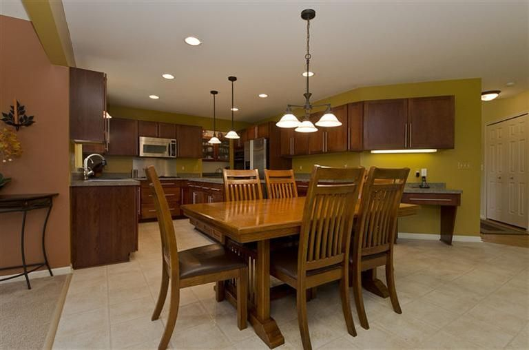 Upgraded kitchen with maple cabinets double oven walk in pantry and
